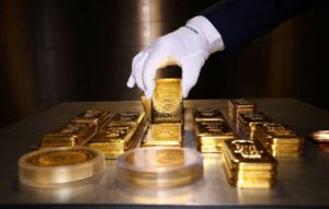 FILE PHOTO: Gold bars and coins are stacked in the safe deposit boxes room of the Pro Aurum gold house in Munich